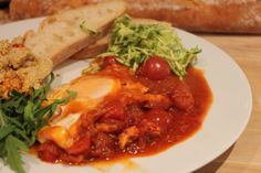 Shakshouka with Baby Marrow - delicious spicy tomato with a gooey egg and hummus. Mopped up with some crusty bread Thai Red Curry, Hummus, Spicy, Egg, Salt, Bread, Chicken, Ethnic Recipes, Food
