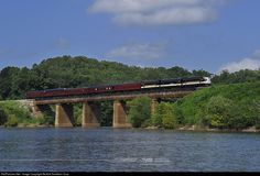 "Norfolk Southern F9a 4270, F7b 4276, and F9a 4271 leads a 5 car ""office car special"" across the Tugaloo River near Toccoa, GA. The head end of the train has just crossed into South Carolina, while the rear is still in Georgia. The train was in Atlanta for an event the day before, and is deadheading back towards its ""home"" in Altoona, PA. Photo by Casey Thomason."