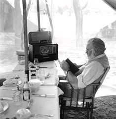 KENYA - SEPTEMBER Author Ernest Hemingway reads and listens to the radio at the dining table while on a big game hunt in September 1952 in Kenya. (Photo by Earl Theisen/Getty Images)Image provided by Getty Images.