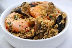 Seafood rice or arroz marinero is a Latin/South American dish similar to Spanish paella, that is made with rice, shrimp, clams, squid, bay scallops, onions, garlic, bell pepper, cilantro and spices.