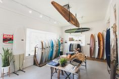 Inside Almond Surfboards, courtesy of Cam Oden. Design Café, Store Design, Cafe Interior, Shop Interior Design, Surfboard Shop, Surfboard Decor, Surf Style Home, Surf Store, Surf House