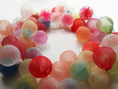 These beautiful, intriguing orbs are designed by Japanese artist Mariko Kusumoto. Each translucent orb contains smaller objects from which she then creates both sculptural and 3D jewellery. She has a wonderful intuitive sense of colour and form that puts a smile on my face! www.aloeforever.uk.com
