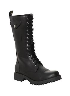 Black combat boots with snap button closure stash pockets, side zip closures, eyelet grommets and black laces. Black rubber outsoles.