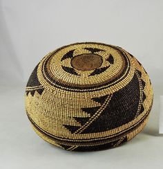 A girl's hat woven by the Yurok or Hupa tribes of northern California, circa 1930s.