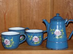 Set of one blue teapot and three cups, adorned with roses in relief. Very pretty, very old, with riveted handles.(End 1800s). Only one cup shows some wear, see photo. The teapot and one of the cups is signed on the bottom. Presumably French, but I am not totally sure of that. Cups are 9.5 cm wide and 7 cm high, Teapot is 16.5 cm high and 11 cm diameter on the bottomside.  This set comes in an overall excellent condition.