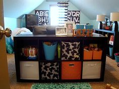 use a storage unit as a space divider and also works as toy storage as well.