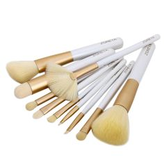 Price:$25.00 Material: Artificial Fibre Color: White 10 pcs Comestic Makeup Brushes Set Kit with Beige Bag