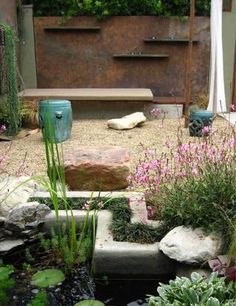 Ketti Kupper's Los Angeles garden -I especially love the finish on the back wall...love the modern cement border and plantings around the pond