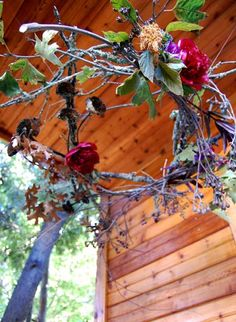 Rustic wreath hanging from the porch ceiling!