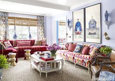 The boldest gesture in the vibrant living room is Hickory Chair's Carter sofa, upholstered in an overscale ikat by Brunschwig & Fils. A John Rosselli & Associates cocktail table holds design and art books. The swing-arm sconce is by Visual Comfort.