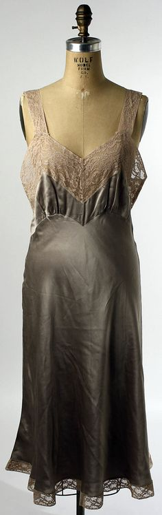 Slip Date: 1940s Culture: American Medium: silk, cotton Dimensions: Length (from shoulder): 46 in. (116.8 cm) Credit Line: Gift of Mrs. C. O. Kalman, 1979 Accession Number: 1979.569.48 This artwork is not on display