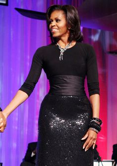 Michelle Obama wore a Michael Kors sequin fishtail skirt, black top and a corset belt by Peter Soronen.
