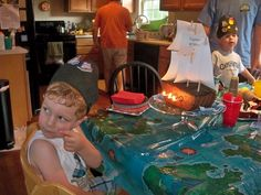 pirate cake with candle cannons. Could you replace the candles with sparklers though because it would look awesome in pictures?