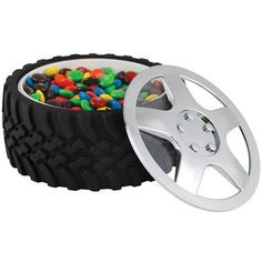 "Know a NASCAR fan or just a ""Car Guy""?  Let the men be boys with this completely functional Tire Bowl. This bowl will be the centerpiece of your man's table! It is so realistic looking the boys will feel as though they are in the pits of the Indianapolis Speedway or just hanging out in the garage.   ""The Chrome Hubcap Lid"" snap-locks on with a twist to keep everything from nuts to cereal fresh. It measures 6"" in diameter and 2 1/2"" deep with rubberized tread.  Couldn't get closer than this…"