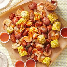 Shrimp, andouille, corn, and potatoes stew together in chicken broth in this slow cooker dish. Use a ladle to serve so partygoers can get some of the flavorful juice. Bring small cups to serve cocktail sauce and/or hot pepper sauce.