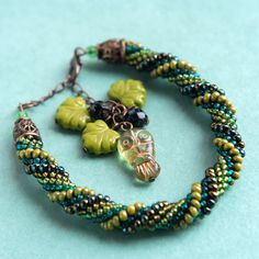 Green Forest Owl Beaded Bracelet with a chain and charm by Osting