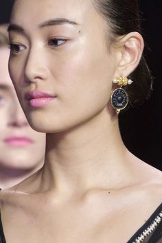 Altuzarra finished his modern take on 18th century romance with intaglio and pearl drop earrings: a singular statement that perfectly summed up the collection. Imaxtree  - HarpersBAZAAR.com