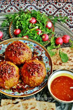 Koofteh Tabrizi is an Azeri specialty named after city of Tabriz. These super 4-inch meatballs are stuffed with dried fruits and nuts