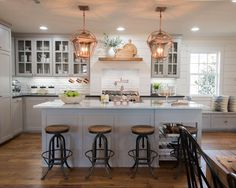 White and gray kitchen, copper light fixtures, white washed shiplap in kitchen, bar stools custom island, via magnolia homes fixer upper