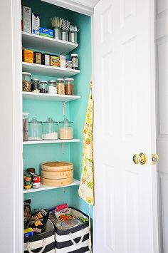 cute, organized mini pantry.  on the list of goals for this weekend.... Paint the inside of the pantry closet!
