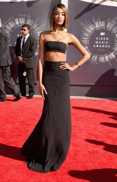 Pin for Later: What All the Stars Wore to the MTV VMAs! Jourdan Dunn at the 2014 MTV VMAs The supermodel showed off her assets in an extreme version of the crop top trend — a black bandeau top and coordinating maxi skirt.