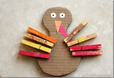 Make a Thanksgiving Turkey with Your Toddler!  Great activity for fine motor skills.
