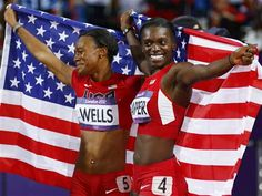 Image: Dawn Harper of the U.S., right, holds her national flag with team mate Kellie Wells