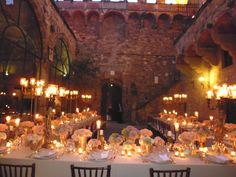Tables ready, Flowers, candles lit and guests can walk in the magic court inside the castle to enjoy the 3 course Menu tailor for the Wedding in Tuscany. All Rights Reserved GUIDI LENCI www.guidilenci.com