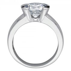 Named for the Hawaiian lunar deity, the Mahina ring brings to mind the beauty and romance of a bright full moon. The half-bezel setting adds a modern twist to a solitaire design that showcases the brilliance of the Contemporary Nexus Diamond™, and the wider band feels solid on your finger.  Center stone is available in a variety of carat weights; choose yours from the menu above. Looking for a matching band? Contact Forever Artisans to have one made for this ring. Order additional services…