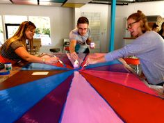 We had all hands on deck in this week's GroupMind! We spent the hour painting a colorful backdrop for an upcoming company event. Pizza may or may not have been involved.