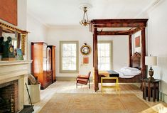 An 1839 tester bed dressed in Pratesi linens stands atop salvaged 1830s pine floorboards in the Hudson Valley, New York, home of photographer Pieter Estersohn.