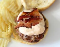 Stuffed Chipotle Bacon Cheese Burgers  - A juicy, spicy burger made with chipotle peppers, bacon and stuffed with cheddar cheese and topped with a spicy, healthy creamy sauce.