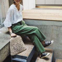 green trousers, white blouse and converse