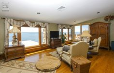 This sensational sitting area is part of a master bedroom suite where we installed all new casement and picture windows. What a view!   Home Remodeling / Home Improvement / Renovation / Replacement windows from Renewal by Andersen Long Island
