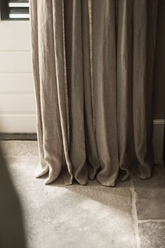 Linen curtains pooling on floor. Very fashionable but not for me!