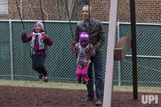 U.S. President Barack Obama pushes children on swings part of the 'Malia and Sasha's Castle', a play-set that was formerly used by the…