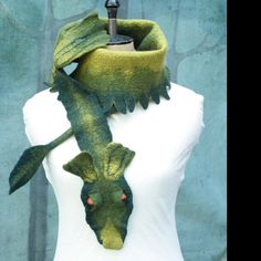 Inspired by a book series I am not allowed to name, the pet Common Swamp Dragon is considered high fashion amongst discerning Morporkians. These hand felted wool scarves are sure to ignite delight everywhere they go. The tail tucks through a strap under the neck. Can also be worn as more of a shawl or bandolier. This dragon can be ordered in any color combination you like.  All of my scarves are hand felted Merino wool from non- tail docked sheep.  The nature of hand felted wool means that…