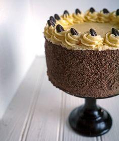 Tiramisu Layer Cake - Coffee, chocolate sponge and vanilla sponge in alternate layers, sandwiched with soft, coffee cream cheese frosting and grated dark chocolate.