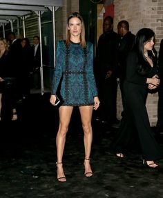 Alessandra Ambrosio wore a jewel-toned patterned minidress that would be perfect for date night.