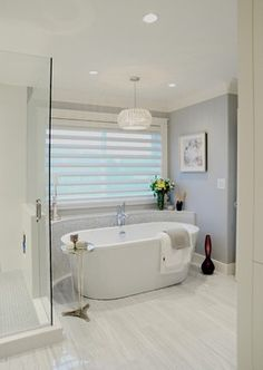 A soothing bathroom retreat with Silhouette® window shadings. ♦ Hunter Douglas window treatments