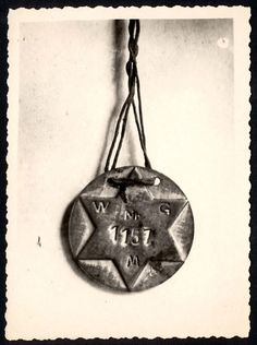 A prisoners pendant, with the number 1157 inside a Star of David.