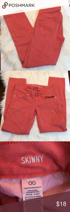 AE Coral Skinny Jeans American eagle coral stretch skinny jeans. Waist is 14 across laying flat, rise is 6.5, inseam is 26. Open to offers and 30% off bundles! American Eagle Outfitters Jeans Skinny