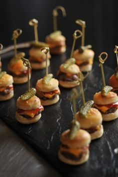 Love this idea of garnishing cheeseburger sliders with a mini size pickle, for Game Day! (inspiration pic only)