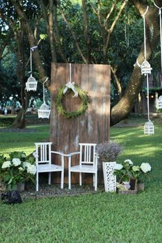 Photo booth backdrop with wood and green elements