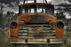 Sitting among a collection of old fire trucks, delivery trucks and other construction-type vehicles along US Gm Trucks, Tow Truck, Fire Trucks, Wrecking Yards, Antique Bicycles, Rusty Cars, Abandoned Cars, Chevy Pickups, Chevrolet Trucks