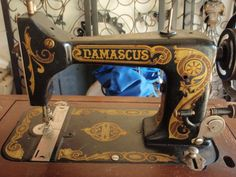 Damascus sewing machine with awesome decorative head.