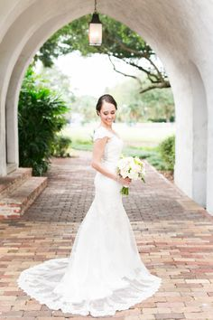 Aline cap sleeve wedding dress: http://www.stylemepretty.com/florida-weddings/winter-park-fl/2016/12/15/outdoor-fall-wedding/ Photography: Amalie Orrange - http://amalieorrangephotography.com/