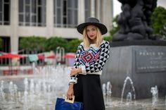 BITS 'N KNITS Liz Cherkasova at Late Afternoon: print sweater, black skater skirt, blue cobalt bag, hat