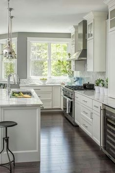 traditional white kitchen ideas. Gray And White Kitchen Features A Island Topped With Marble Countertop Seating Backless Iron Bar Stool Completed Sliding Traditional Ideas S