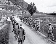 Republic of Korea (ROK) soldiers march in typical column formation toward the front in August, 1950, during the Pusan Perimeter battle. This is a standard narrow dirt Korean road raised above rice paddies. (U.S. Army photo.)